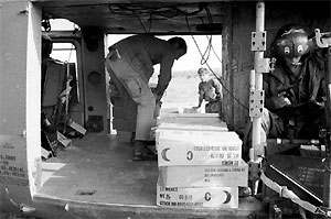 C-rations being off loaded to troops