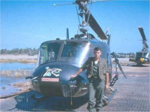 "Lt. Roger Winslow with maintenance ship ""roadrunner"" Vinh Long 1964"