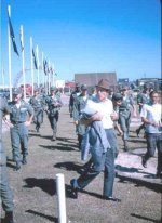 Bob Hope heads for mess hall Dec 1964, Cpt. Chuck Shipman (hands on hips) and white knight ce's